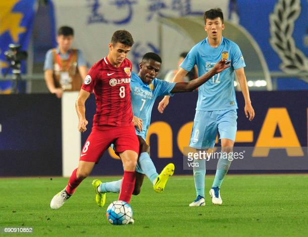 Oscar of Shanghai SIPG and Ramires of Jiang Suning compete for the ball during 2017 AFC Champions League Round of 16 between Jiangsu Suning and...