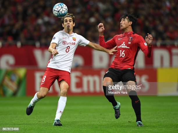 Oscar of Shanghai SIPG and Takuya Aoki of Urawa Red Diamonds compete for the ball during the AFC Champions League semi final second leg match between...
