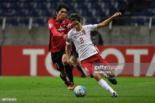 Oscar of Shanghai SIPG and Yosuke kashiwagi of Urawa Red Diamonds compete for the ball during the AFC Champions League semi final second leg match...