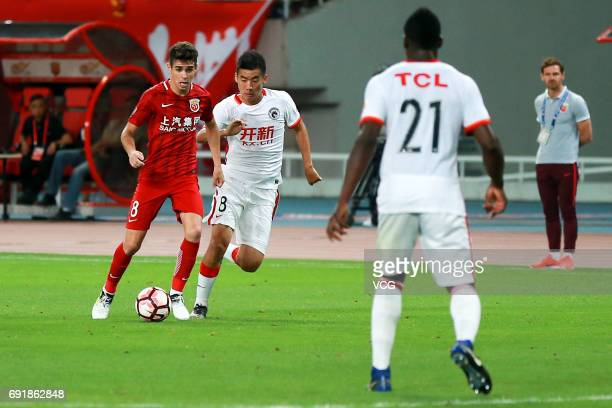 Oscar of Shanghai SIPG and Zhang Ye of Liaoning Whowin compete for the ball during the 12th round match of 2017 Chinese Football Association Super...