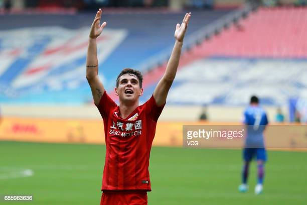 Oscar of Shanghai SIPG celebrates after scoring a goal during the 10th round match of CSL Chinese Football Association between Shanghai Shenhua and...