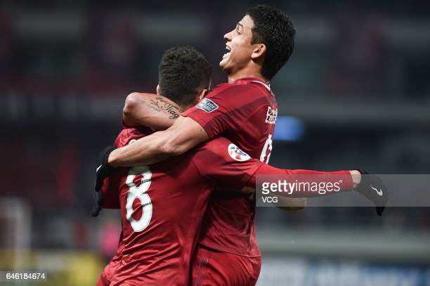 Oscar of Shanghai SIPG celebrates with Elkeson after scoring his team's second goal during the AFC Champions League 2017 Group F match between...