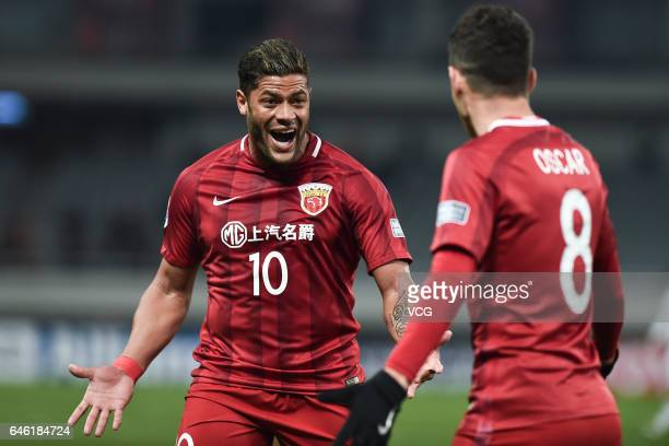Oscar of Shanghai SIPG celebrates with Hulk after scoring his team's second goal during the AFC Champions League 2017 Group F match between Shanghai...