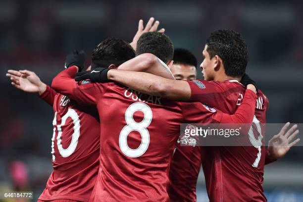 Oscar of Shanghai SIPG celebrates with team mates after scoring his team's second goal during the AFC Champions League 2017 Group F match between...