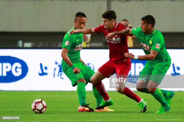 Oscar of Shanghai SIPG competes for the ball with Zhang Chiming and Ralf of Beijing Guoan during the 11th round match of 2017 Chinese Football...