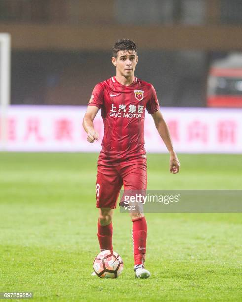 Oscar of Shanghai SIPG controls the ball during the 13th round match of 2017 Chinese Football Association Super League between Guangzhou Fuli and...