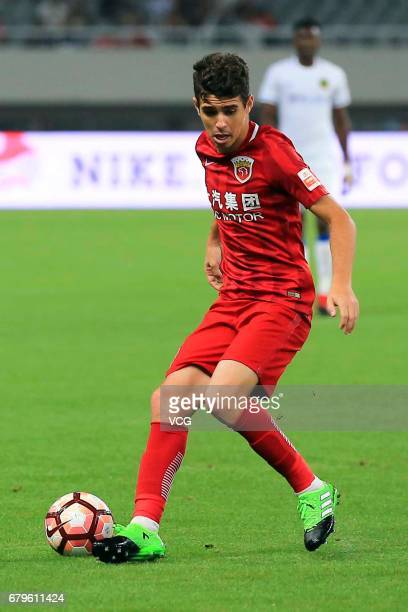 Oscar of Shanghai SIPG dribbles during the eighth round match of 2017 Chinese Football Association Super League between Shanghai SIPG and Guizhou...