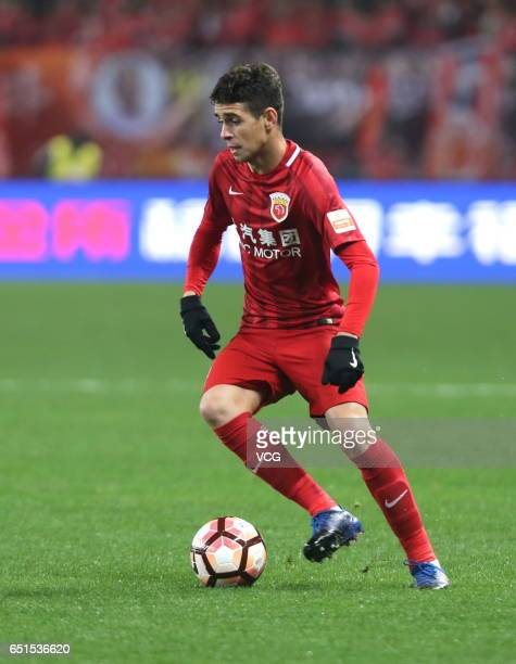 Oscar of Shanghai SIPG drives the ball during the 2nd round match of Chinese Super League between Shanghai SIPG and Yanbian Fude FC at Shanghai...