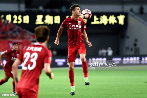 Oscar of Shanghai SIPG heads the ball during the 11th round match of 2017 Chinese Football Association Super League between Shanghai SIPG and Beijing...