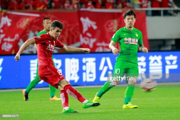 Oscar of Shanghai SIPG passes the ball during the 11th round match of 2017 Chinese Football Association Super League between Shanghai SIPG and...