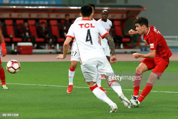 Oscar of Shanghai SIPG passes the ball during the 12th round match of 2017 Chinese Football Association Super League between Shanghai SIPG and...