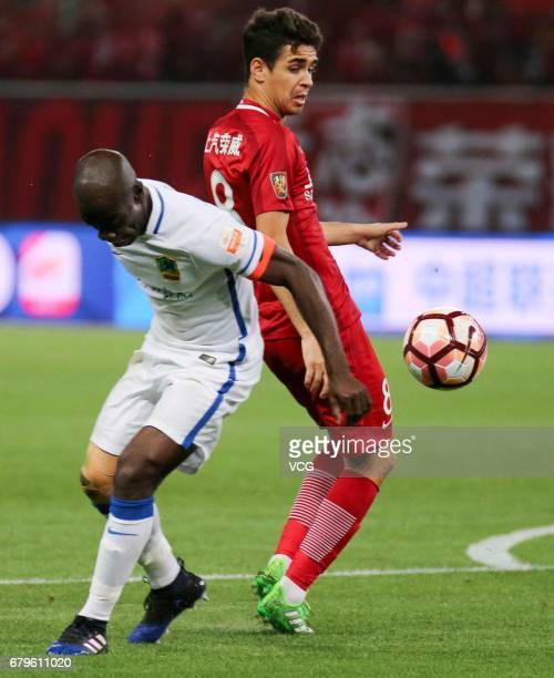Oscar of Shanghai SIPG reacts during the eighth round match of 2017 Chinese Football Association Super League between Shanghai SIPG and Guizhou...