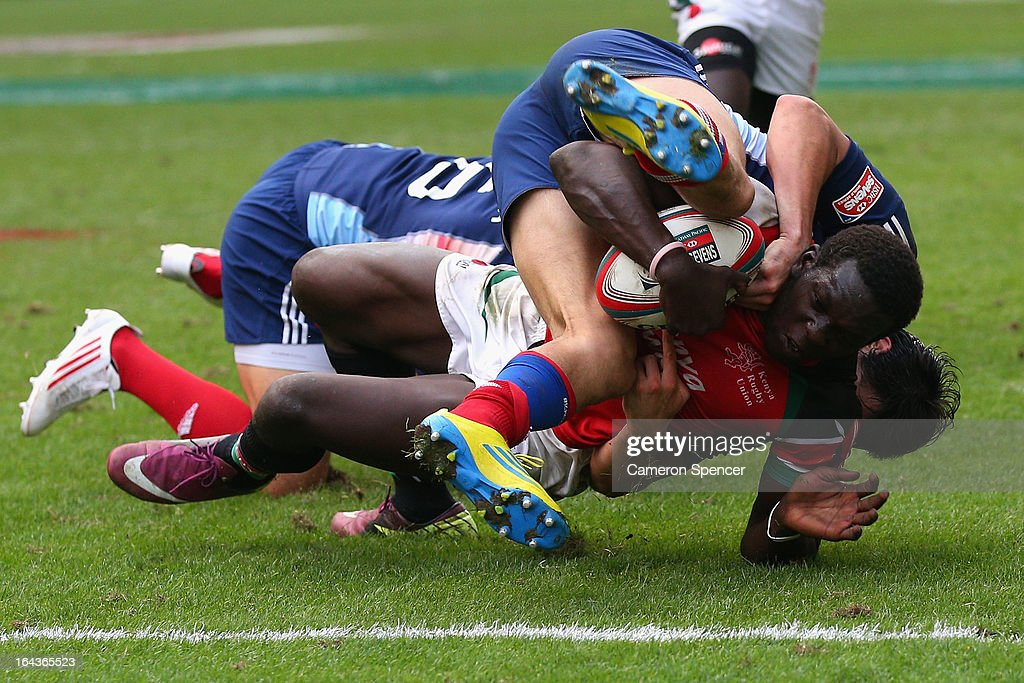 Oscar Ouma of Kenya is tackled short of the tryline during the match between France and Kenya during day two of the 2013 Hong Kong Sevens at Hong Kong Stadium on March 23, 2013 in So Kon Po, Hong Kong.