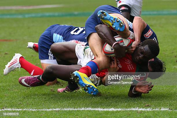 Oscar Ouma of Kenya is tackled short of the tryline during the match between France and Kenya during day two of the 2013 Hong Kong Sevens at Hong...