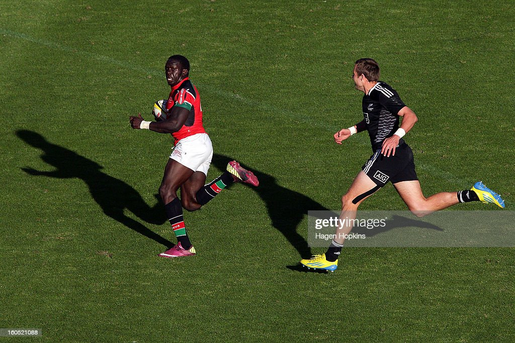 Oscar Ouma of Kenya makes a break from Tim Mikkelson of the All Blacks Sevens in the semifinal cup match between New Zealand and Kenya during the 2013 Wellington Sevens at Westpac Stadium on February 2, 2013 in Wellington, New Zealand.