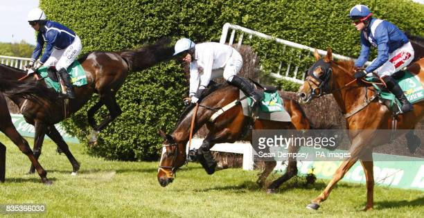 Oscar Park jockey Timmy Murphy fall during the Bet365 Gold Cup Handicap Chase during the bet365 Gold Cup Meeting at Sandown Park Racecourse Surrey