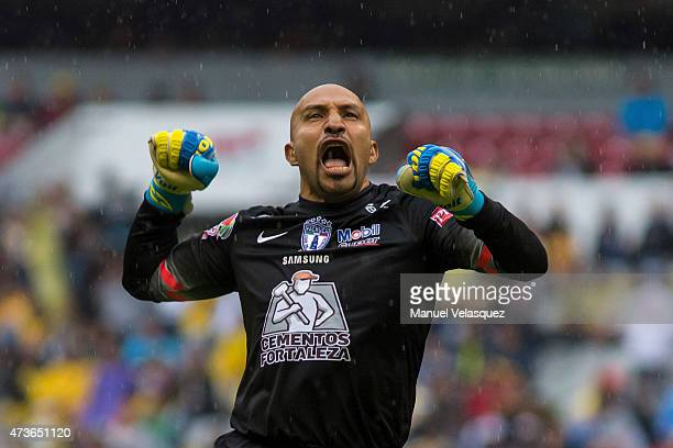 Oscar Perez celebrates a goal scored by teammate Cristian Penilla during a quarterfinal second leg match between America and Pachuca as part of...