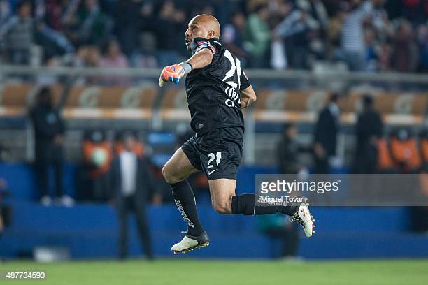 Oscar Perez goalkeeper of Pachuca celebrates after a goal of his teammate Dario Carre–o during the Quarterfinal first leg match between Pumas UNAM...