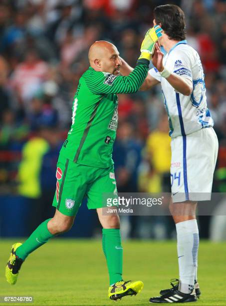 Oscar Perez goalkeeper of Pachuca celebrates with teammate Omar Gonzalez after scoring the second goal of his team during a match between Pachuca and...