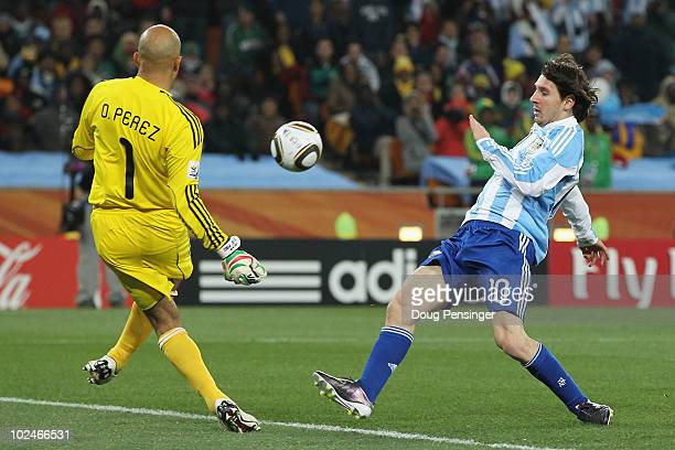 Oscar Perez of Mexico defends an attack from Lionel Messi of Argentina during the 2010 FIFA World Cup South Africa Round of Sixteen match between...