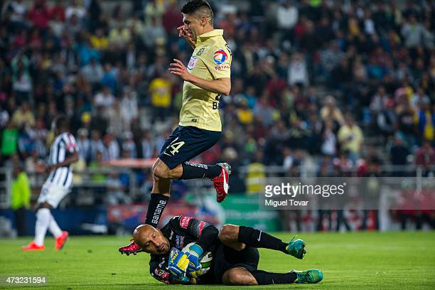Oscar Perez of Pachuca takes the ball away from Oribe Peralta of America during a quarterfinal first leg match between Pachuca and America as part of...