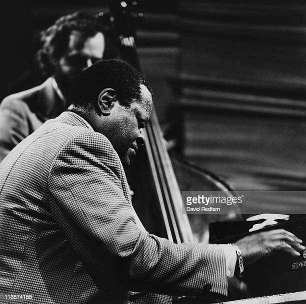 Oscar Peterson Canadian jazz pianist and Danish jazz bassist NielsHenning Orsted Pedersen during a live concert performance at Ronnie Scott's in...