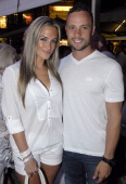 Oscar Pistorius and Reeva Steenkamp at the Tasha's All White Party on January 26 2012 in Johannesburg South Africa