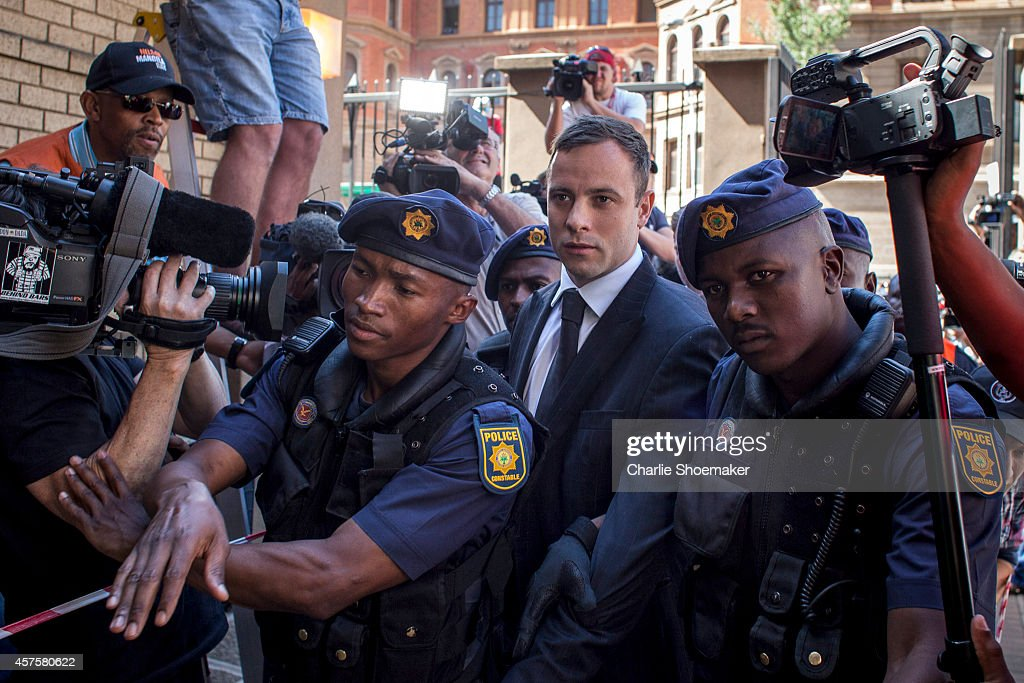 <a gi-track='captionPersonalityLinkClicked' href=/galleries/search?phrase=Oscar+Pistorius&family=editorial&specificpeople=224406 ng-click='$event.stopPropagation()'>Oscar Pistorius</a> arrives at the North Gauteng High Court for sentencing on October 21, 2014 in Pretoria, South Africa. Pistorius will today be sentenced after been found guilty of the culpable homicide of his girlfriend Reeva Steenkamp, after he shot Steenkamp, claiming he mistook her for an intruder.