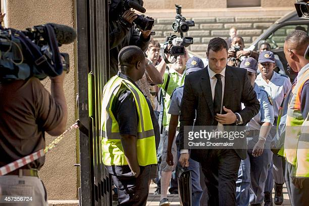 Oscar Pistorius arrives at the North Gauteng High Court for the fifth day of sentencing on October 17 2014 in Petoria South Africa Pistorius will be...