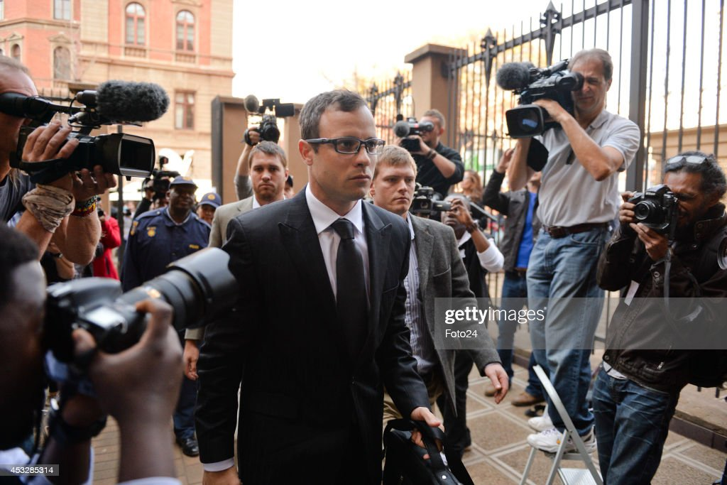 <a gi-track='captionPersonalityLinkClicked' href=/galleries/search?phrase=Oscar+Pistorius&family=editorial&specificpeople=224406 ng-click='$event.stopPropagation()'>Oscar Pistorius</a> arrives at the Pretoria High Court on August 7, 2014, in Pretoria, South Africa. <a gi-track='captionPersonalityLinkClicked' href=/galleries/search?phrase=Oscar+Pistorius&family=editorial&specificpeople=224406 ng-click='$event.stopPropagation()'>Oscar Pistorius</a>, stands accused of the murder of his girlfriend, Reeva Steenkamp, on February 14, 2014. This is Pistorius' official trial, the result of which will determine the paralympian athlete's fate. Closing arguements begin today.