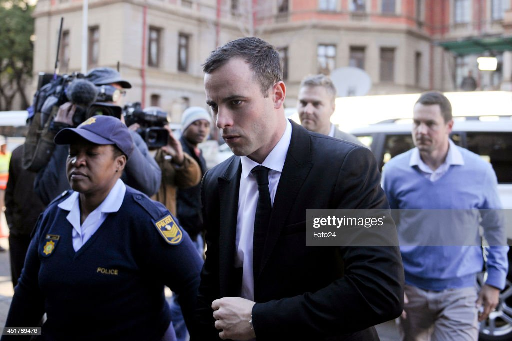 <a gi-track='captionPersonalityLinkClicked' href=/galleries/search?phrase=Oscar+Pistorius&family=editorial&specificpeople=224406 ng-click='$event.stopPropagation()'>Oscar Pistorius</a> arrives at the Pretoria High Court on July 7, 2014, in Pretoria, South Africa. <a gi-track='captionPersonalityLinkClicked' href=/galleries/search?phrase=Oscar+Pistorius&family=editorial&specificpeople=224406 ng-click='$event.stopPropagation()'>Oscar Pistorius</a>, stands accused of the murder of his girlfriend, Reeva Steenkamp, on February 14, 2014. This is Pistorius' official trial, the result of which will determine the paralympian athlete's fate.