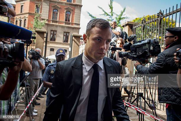 Oscar Pistorius arrives for the fourth day of sentencing at North Gauteng High Court on October 16 2014 in Pretoria South Africa Pistorius will be...