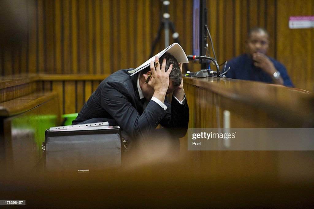 <a gi-track='captionPersonalityLinkClicked' href=/galleries/search?phrase=Oscar+Pistorius&family=editorial&specificpeople=224406 ng-click='$event.stopPropagation()'>Oscar Pistorius</a> at the Pretoria High Court on March 13, 2014, in Pretoria, South Africa. Pistorius, stands accused of the murder of his girlfriend, Reeva Steenkamp, on February 14, 2014. This is <a gi-track='captionPersonalityLinkClicked' href=/galleries/search?phrase=Oscar+Pistorius&family=editorial&specificpeople=224406 ng-click='$event.stopPropagation()'>Oscar Pistorius</a>' official trial, the result of which will determine the paralympian athlete's fate.
