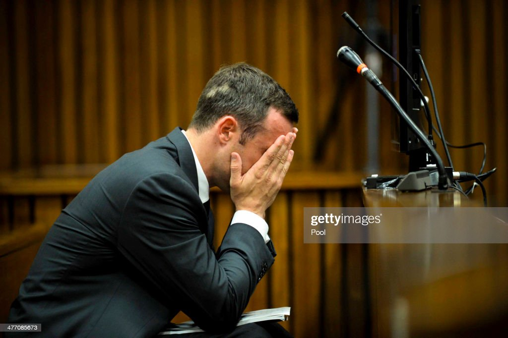 <a gi-track='captionPersonalityLinkClicked' href=/galleries/search?phrase=Oscar+Pistorius&family=editorial&specificpeople=224406 ng-click='$event.stopPropagation()'>Oscar Pistorius</a> at the Pretoria High Court on March 7, 2014, in Pretoria, South Africa. Pistorius, stands accused of the murder of his girlfriend, Reeva Steenkamp, on February 14, 2014. This is Pistorius' official trial, the result of which will determine the paralympian athlete's fate.