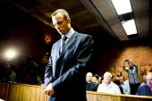 Oscar Pistorius at the Pretoria Magistrates court on February 22 in Pretoria South Africa Pistorius is accused of the murder of Reeva Steenkamp on...