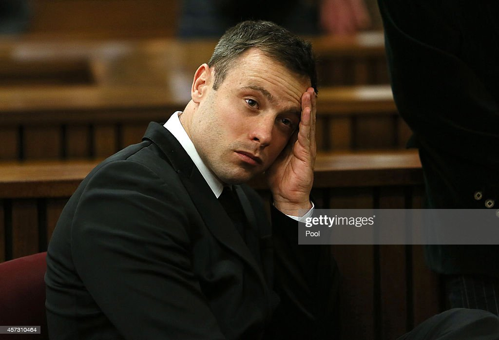 <a gi-track='captionPersonalityLinkClicked' href=/galleries/search?phrase=Oscar+Pistorius&family=editorial&specificpeople=224406 ng-click='$event.stopPropagation()'>Oscar Pistorius</a> attends his sentencing hearing in the Pretoria High Court on October 16, 2014, in Pretoria, South Africa. Judge Thokozile Masipa found Pistorius not guilty of murdering his girlfriend Reeva Steenkamp, but convicted him of culpable homicide. Sentencing continues today.