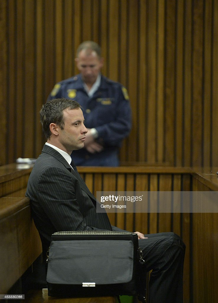 Oscar Pistorius during his murder trial in the Pretoria High Court on August 8, 2014, in Pretoria, South Africa. Oscar Pistorius stands accused of the murder of his girlfriend, Reeva Steenkamp, on February 14, 2013. This is Pistorius' official trial, the result of which will determine the paralympian athlete's fate.