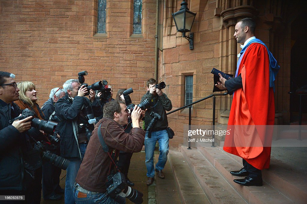 Oscar Pistorius holds his scroll after receiveing his honorary doctorate from Strathclyde University in the Barony Hall on November 12 2012 in...