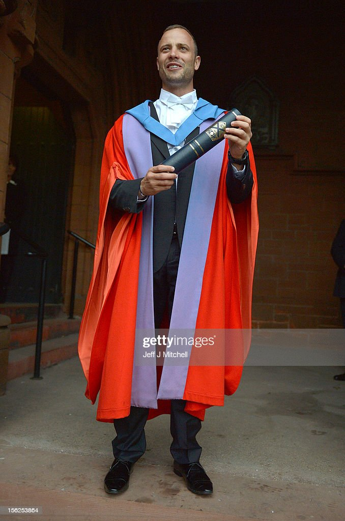 Oscar Pistorius, holds his scroll after receiveing his honorary doctorate from Strathclyde University in the Barony Hall on November 12, 2012 in Glasgow, United Kingdom. The athlete was made a Doctor of the University after competing at both the Olympic and Paralympic Games, where he won two gold medals and a silver medal. Oscar became the first paralympian to win a medal at an able bodied championship at the 2011 World Athletics Championships. He went on to compete at the London 2012 Olympic Games where he ran in the 400m and the relay earlier this year.