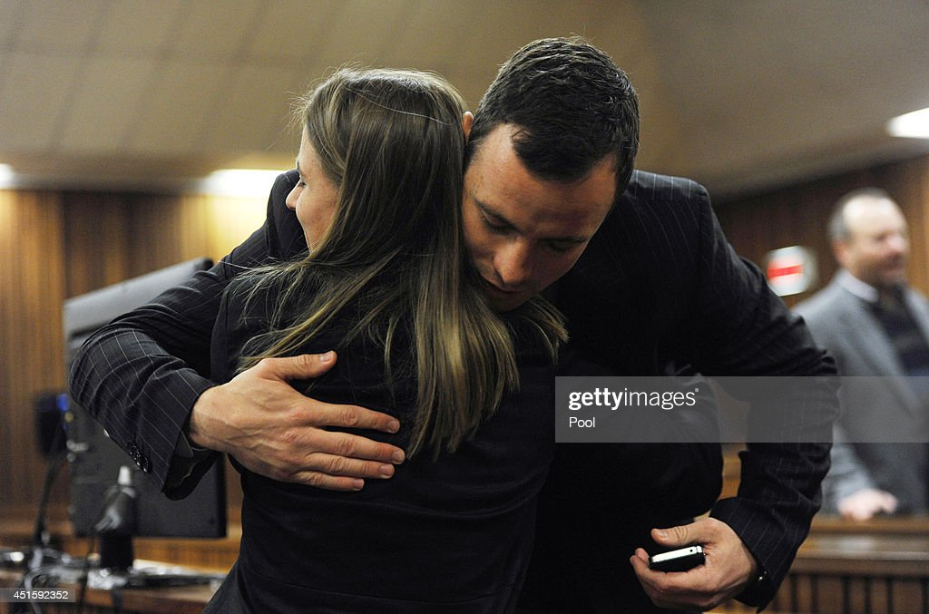<a gi-track='captionPersonalityLinkClicked' href=/galleries/search?phrase=Oscar+Pistorius&family=editorial&specificpeople=224406 ng-click='$event.stopPropagation()'>Oscar Pistorius</a> hugs a supporter in the Pretoria High Court on July 2, 2014, in Pretoria, South Africa. <a gi-track='captionPersonalityLinkClicked' href=/galleries/search?phrase=Oscar+Pistorius&family=editorial&specificpeople=224406 ng-click='$event.stopPropagation()'>Oscar Pistorius</a> stands accused of the murder of his girlfriend, Reeva Steenkamp, on February 14, 2013. This is Pistorius' official trial, the result of which will determine the paralympian athlete's fate.