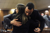 Oscar Pistorius hugs a supporter in the Pretoria High Court on July 2 in Pretoria South Africa Oscar Pistorius stands accused of the murder of his...
