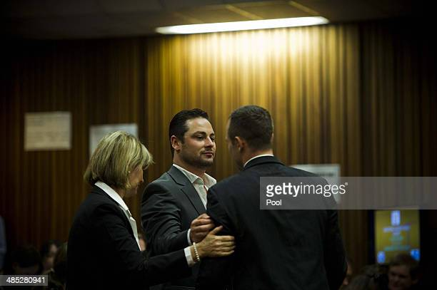 Oscar Pistorius is comforted by brother Carl Pistorius in the Pretoria High Court on April 17 in Pretoria South Africa Oscar Pistorius stands accused...