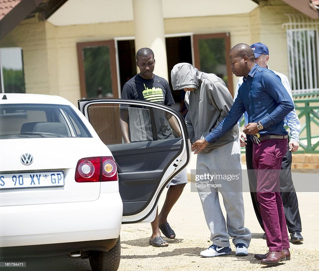 Oscar Pistorius leave Boschkop Police Station on February 14, 2013 in Pretoria, South Africa. Pistorius was then taken to hospital for a blood test, prior to his appearance at court. He was arrested following a shooting at his residence on the morning of February 14, 2013.