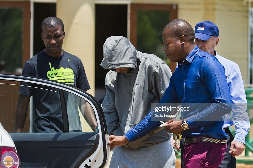 Oscar Pistorius leaves Boschkop Police Station on February 14, 2013 in Pretoria, South Africa. Pistorius was then taken to hospital for a blood test, prior to his appearance at court. He was arrested following a shooting at his residence on the morning of February 14, 2013.