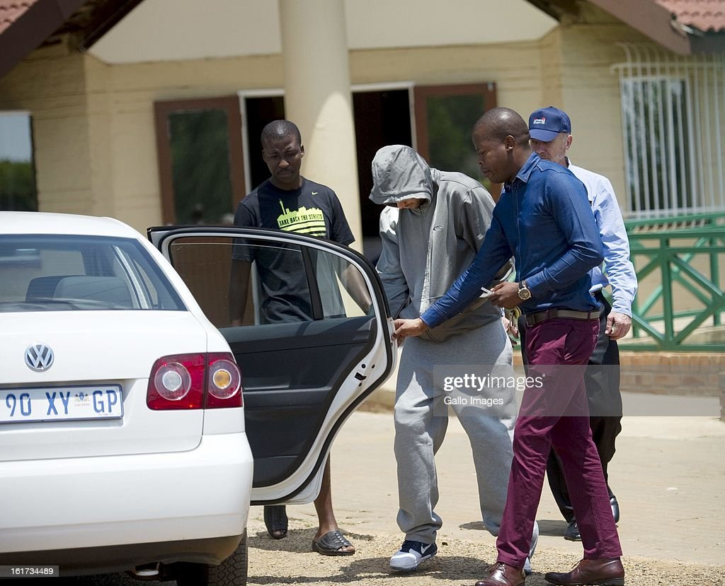 Oscar Pistorius leaves Boschkop Police Station on February 14, 2013 in Pretoria, South Africa. Pistorius was then taken to hospital for a blood test, prior to his appearance at court. He was arrested following a shooting at his residence on the morning of February 14, 2013