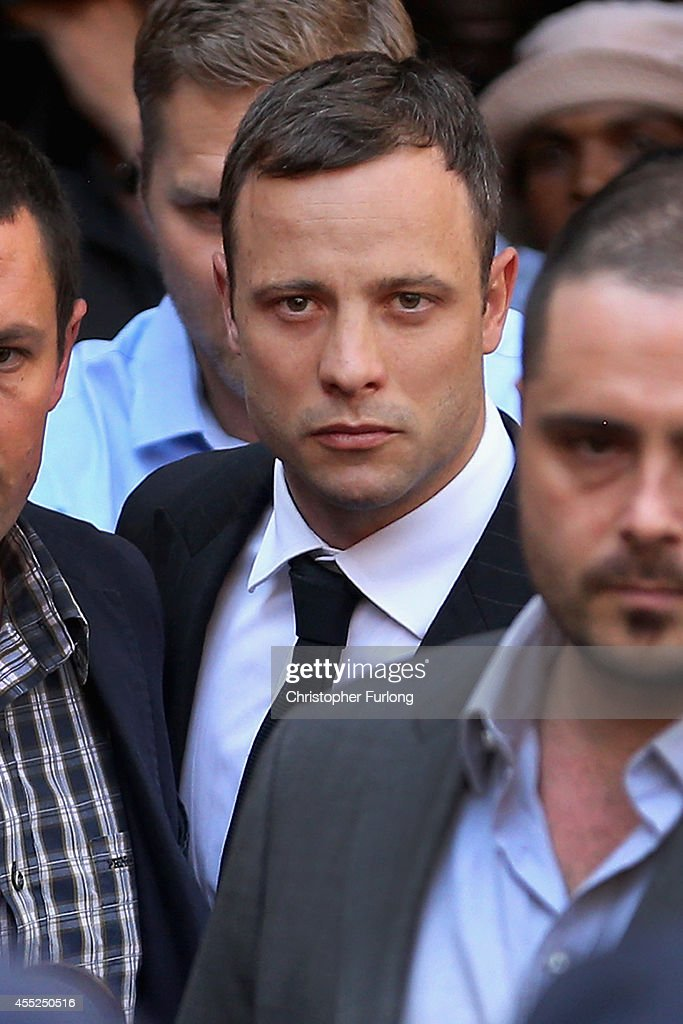<a gi-track='captionPersonalityLinkClicked' href=/galleries/search?phrase=Oscar+Pistorius&family=editorial&specificpeople=224406 ng-click='$event.stopPropagation()'>Oscar Pistorius</a> (C) leaves North Gauteng High Court on September 11, 2014 in Pretoria, South Africa. South African Judge Thokosile Masipa has ruled out murder charges, but has left it to tomorrow to announce whether <a gi-track='captionPersonalityLinkClicked' href=/galleries/search?phrase=Oscar+Pistorius&family=editorial&specificpeople=224406 ng-click='$event.stopPropagation()'>Oscar Pistorius</a> is guilty of culpable homicide as the six month trial of the Olympic double-amputee sprinter comes to an end. His defence maintained that Mr Pistorius mistook Ms Reeva Steenkamp for an intruder in his home when he fired several shots into his bathroom allegedly in self-defence but killing his girlfriend..