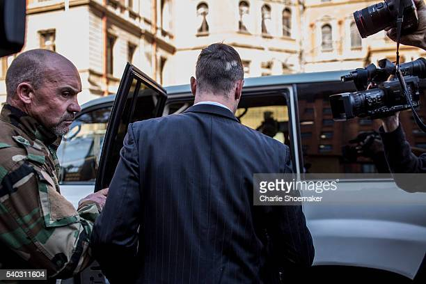 Oscar Pistorius leaves the North Gauteng High Court for lunch after removing his removing prosthetic legs earlier by his defense counsel Barry Roux...