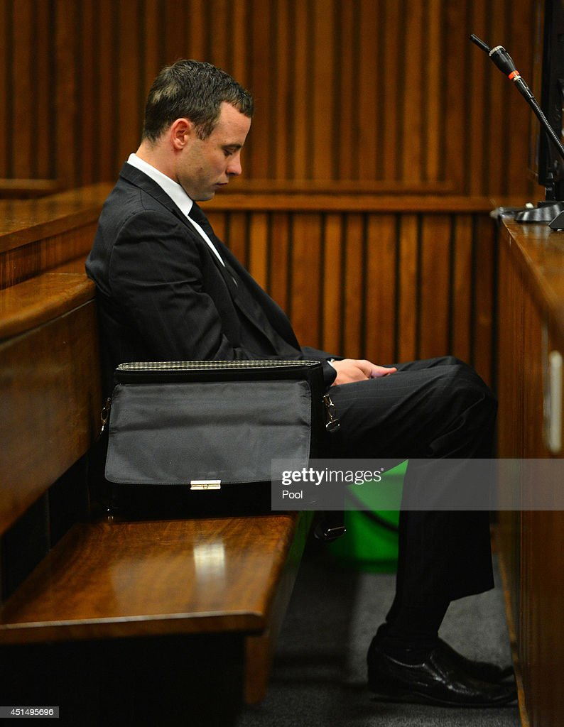 <a gi-track='captionPersonalityLinkClicked' href=/galleries/search?phrase=Oscar+Pistorius&family=editorial&specificpeople=224406 ng-click='$event.stopPropagation()'>Oscar Pistorius</a> listens to evidence in the Pretoria High Court on June 30, 2014, in Pretoria, South Africa. <a gi-track='captionPersonalityLinkClicked' href=/galleries/search?phrase=Oscar+Pistorius&family=editorial&specificpeople=224406 ng-click='$event.stopPropagation()'>Oscar Pistorius</a> stands accused of the murder of his girlfriend, Reeva Steenkamp, on February 14, 2013. This is Pistorius' official trial, the result of which will determine the paralympian athlete's fate.