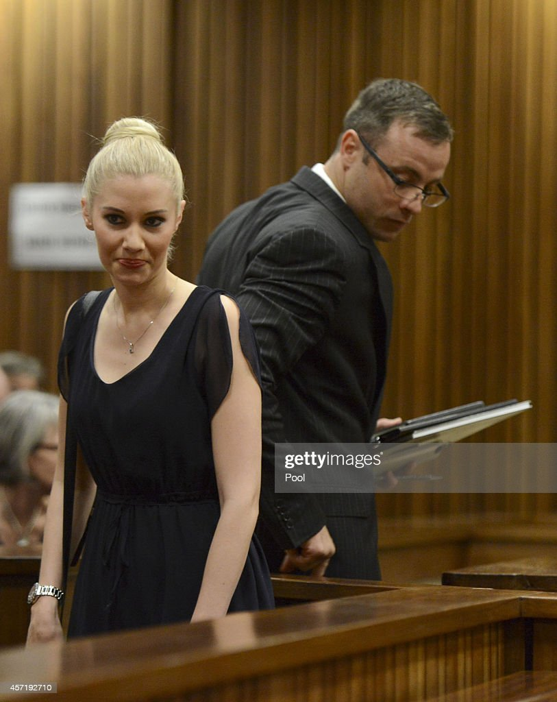 Oscar Pistorius makes his way past his ex girlfriend Samantha Taylor as he arrives in the Pretoria High Court for sentencing in his murder trial on...