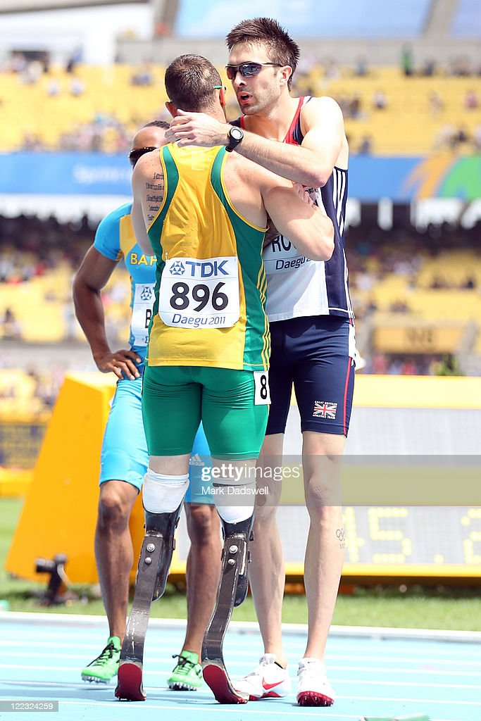 Oscar Pistorius (L) of South Africa and Martyn Rooney of Great Britain congratulate each other after the men's 400 metres heats during day two of the 13th IAAF World Athletics Championships at the Daegu Stadium on August 28, 2011 in Daegu, South Korea.